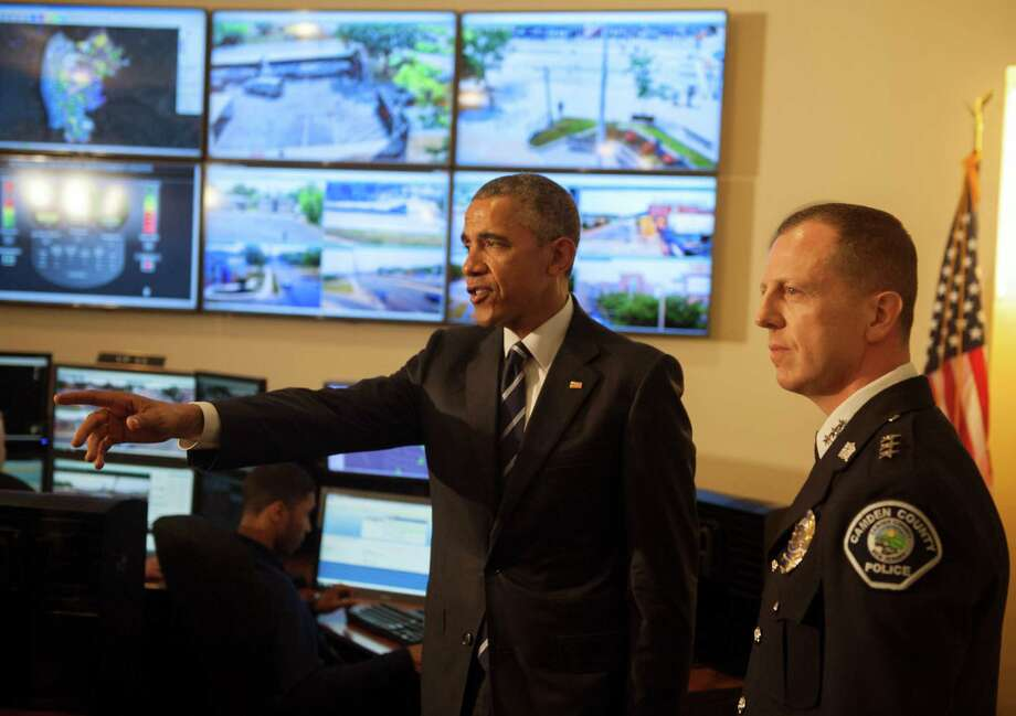 President Barack Obama tours the Real-Time Tacti- cal Operational Intelligence Center in the Camden County Police Administration Building with Camden County Police Chief J. Scott Thomson in New Jersey. Photo: Chris LaChall /Camden Courier-Post / Pool Camden Courier-Post