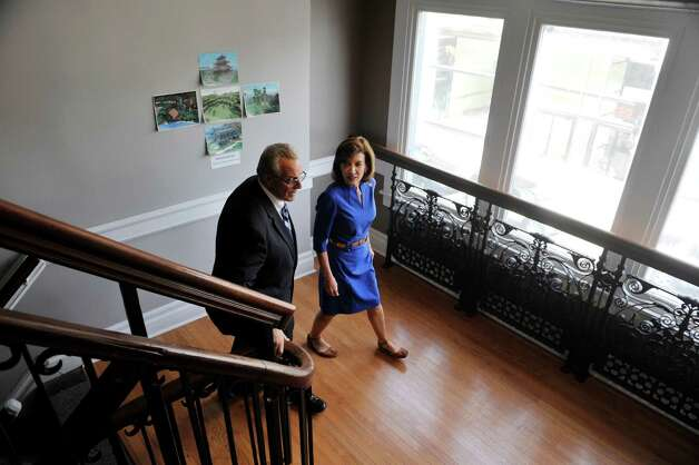 Troy Mayor Lou Rosamilia, left, and New York State Lt. Governor Kathy Hochul make their way up the stairs to 1st Playable Productions on Monday, May 18, 2015, in Troy, N.Y.  Lt. Governor Hochul was given a tour of the business.  (Paul Buckowski / Times Union) Photo: PAUL BUCKOWSKI / 00031882A