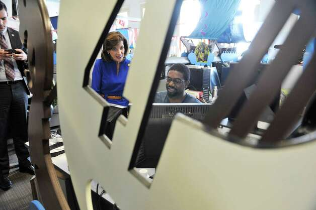 New York State Lt. Governor Kathy Hochul, left, talks with Abdul Brown an artist at 1st Playable Productions on Monday, May 18, 2015, in Troy, N.Y.  Lt. Governor Hochul was given a tour of the business.  (Paul Buckowski / Times Union) Photo: PAUL BUCKOWSKI / 00031882A