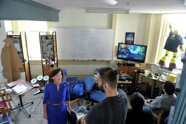 New York State Lt. Governor Kathy Hochul, left, talks with Justin Candeloro, an engineering group manager at 1st Playable Productions on Monday, May 18, 2015, in Troy, N.Y.  Lt. Governor Hochul was given a tour of the business.  (Paul Buckowski / Times Union) Photo: PAUL BUCKOWSKI / 00031882A