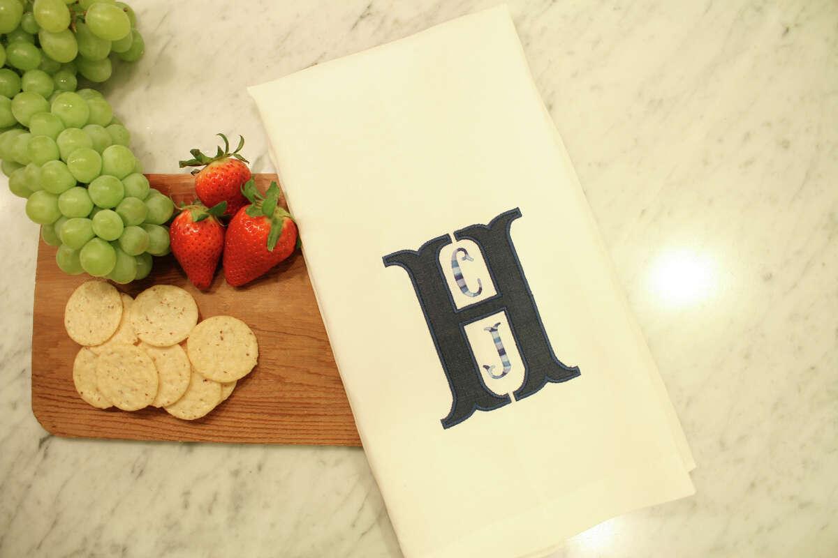 Monogrammed applique hand towels are part of Vanessa Walton's new Jacquelyn Reese Home collection.