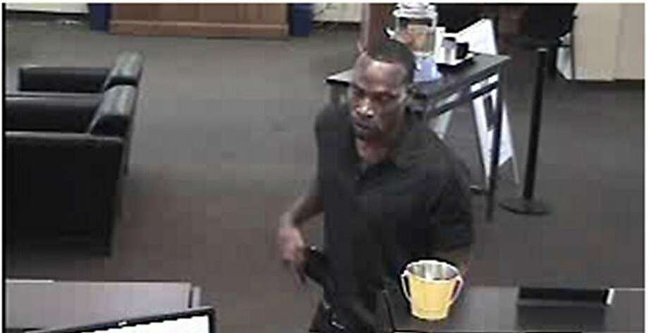 Police and the FBI are searching for this man, who they say robbed six banks in San Francisco and one in Antioch. Photo: Fbi