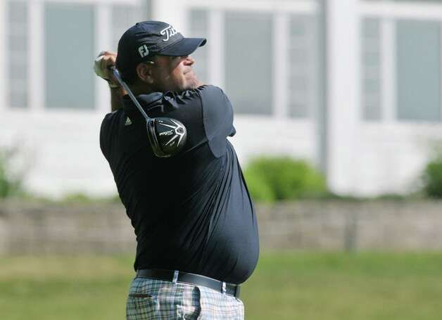 Scott Berliner from Saratoga Springs hits a shot towards the first green during the U.S. Open local qualifier at the Country Club of Troy on Monday, May 18, 2015, in Troy, N.Y. (Paul Buckowski / Times Union) Photo: PAUL BUCKOWSKI / 00031820A