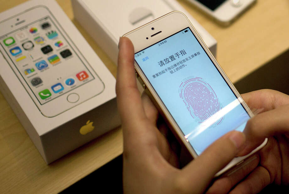 USAA customers now can use Apple's Touch ID to access their banking accounts through the company's mobile app. Photo: Associated Press File Photo / AP