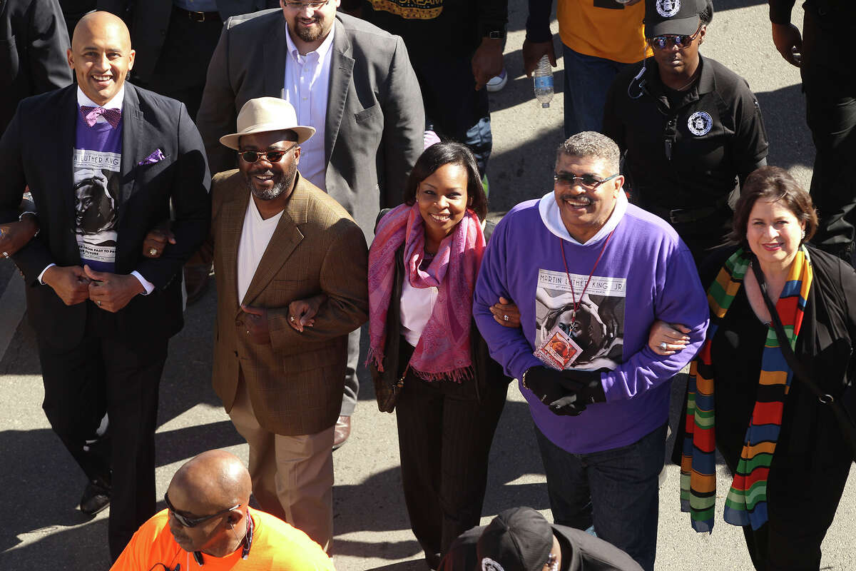 People take part in the 28th Martin Luther King March in San Antonio, Texas Monday Jan. 19, 2015. Pictured left to right are councilman Alan Warrick, Rodney Taylor (Mayor Ivy Taylor's husband). Mayor Ivy Taylor, MLK Commission chairman David Copeland and state senator Leticia Van de Putte.