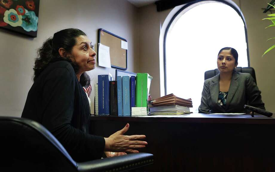 A tearful Lesly Cabrera, left, discusses with her lawyer Claudia Hernandez the next steps in her immigration case.  The Honduran mother is seeking asylum here due to gang violence aimed at her 17 year-old son while they lived in San Pedro Sula, but was denied application for asylum in immigration court on Monday, May 18, 2015. Her son Edwuard has a separate case and hopes to gain residency. Photo: Bob Owen, Staff / San Antonio Express-News / San Antonio Express-News