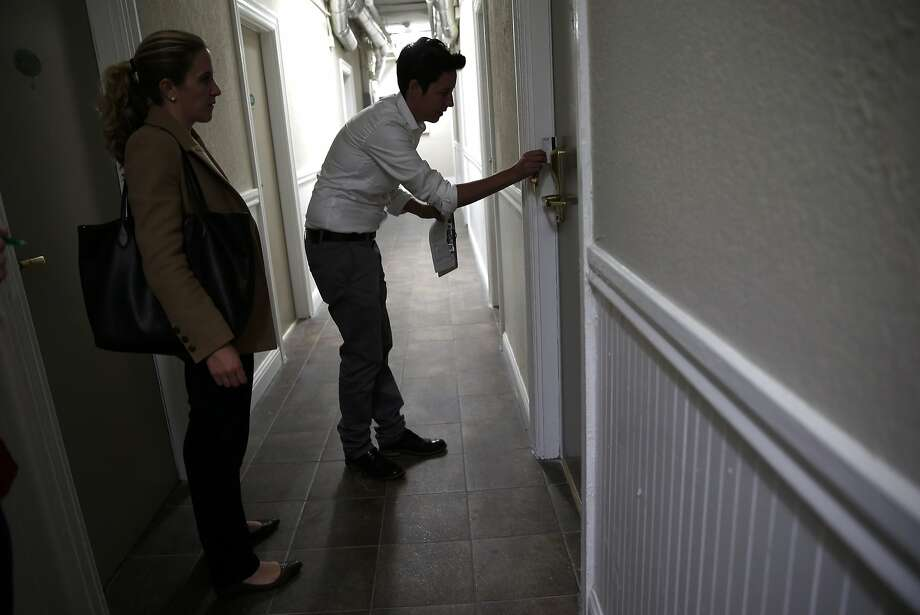 As Megan Filly, Deputy Press Secretary, Superior Court of California, looks on, Krista Gaeta, Deputy Director or Tenderloin Housing Clinic, enters a room at Drake Hotel in San Francisco, Calif., on Monday, May 18, 2015. Photo: Scott Strazzante, The Chronicle