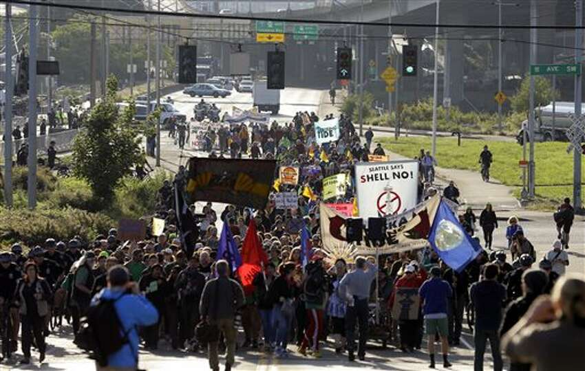 Protesters rally at the Port of Seattle, Monday, May 18, 2015, in Seattle. Demonstrators opposed to Arctic oil drilling were showing opposition to a lease agreement between Royal Dutch Shell and the Port to allow some of Shell's oil drilling equipment to be based in Seattle. (AP Photo/Ted S. Warren)