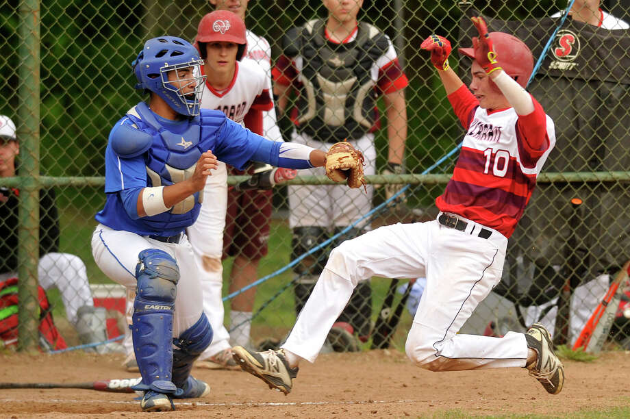Darien catcher Anthony DiMeglio tags New Canaan's Kyle Levasseur out at home during their baseball game at Mead Park in New Canaan, Conn., on Monday, May 18, 2015. Darien won, 6-1. Photo: Jason Rearick / Stamford Advocate