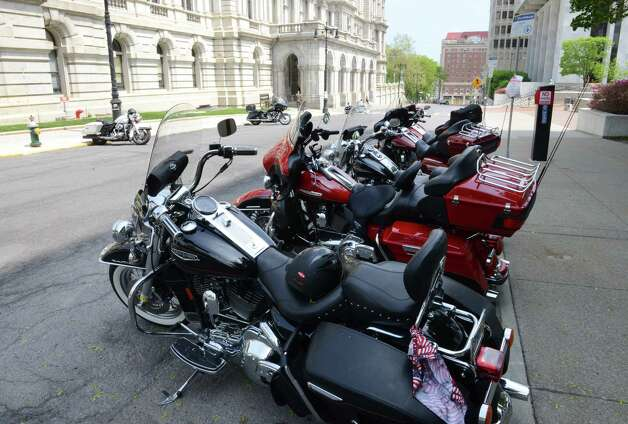 Motorcycle safety advocates parked outside the Capitol on State St. for rally where they met with lawmakers to raise awareness about biker safety Monday afternoon, May 18, 2015, in Albany, N.Y. Parking along State St. was reserved for the bikers. (Will Waldron/Times Union) Photo: WW
