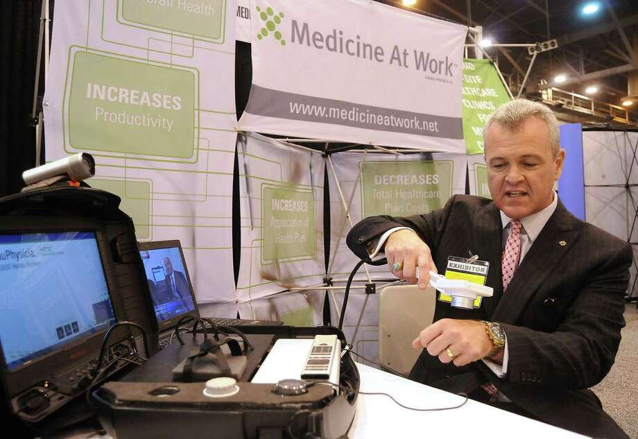 Jay Donnella from Medicine at Work show soff a diagnostic tool that his company uses during a Thursday event in Houston. Photo: Dave Rossman /For The Houston Chronicle / Freelalnce