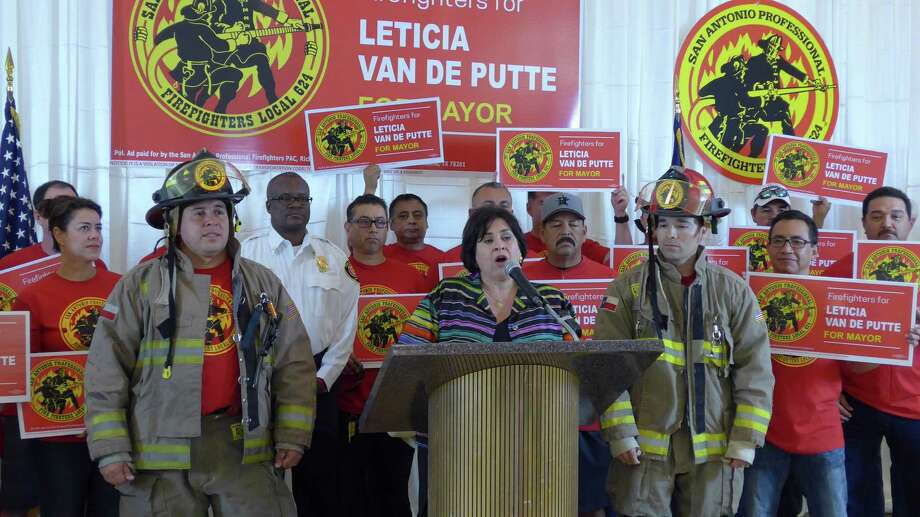 Mayoral candidate Leticia Van de Putte, surrounded by members and supporters of the San Antonio Professional Firefighters Association, accepts the union's endorsement in the June 13 runoff, on Monday May 18, 2015, at association headquarters. Photo: John W. Gonzalez / San Antonio Express-News
