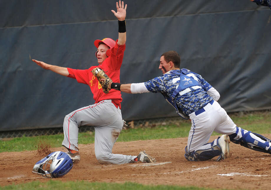 Stratford's John Lagerfeldt slides in safely ahead of the tag of Bunnell catcher Brian Valeriano, scoring from second on a single in the 4th inning of their baseball game at Bunnell High School in Stratford, Conn on Monday, May 18, 2015. Bunnell won the game 2-1 in ten innings. Photo: Brian A. Pounds / Connecticut Post