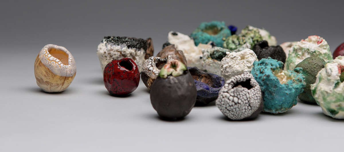 New Yorker Toshiaki Noda uses a wheel to form his ceramic pieces, which resemble interstellar debris or mutant plant pods.