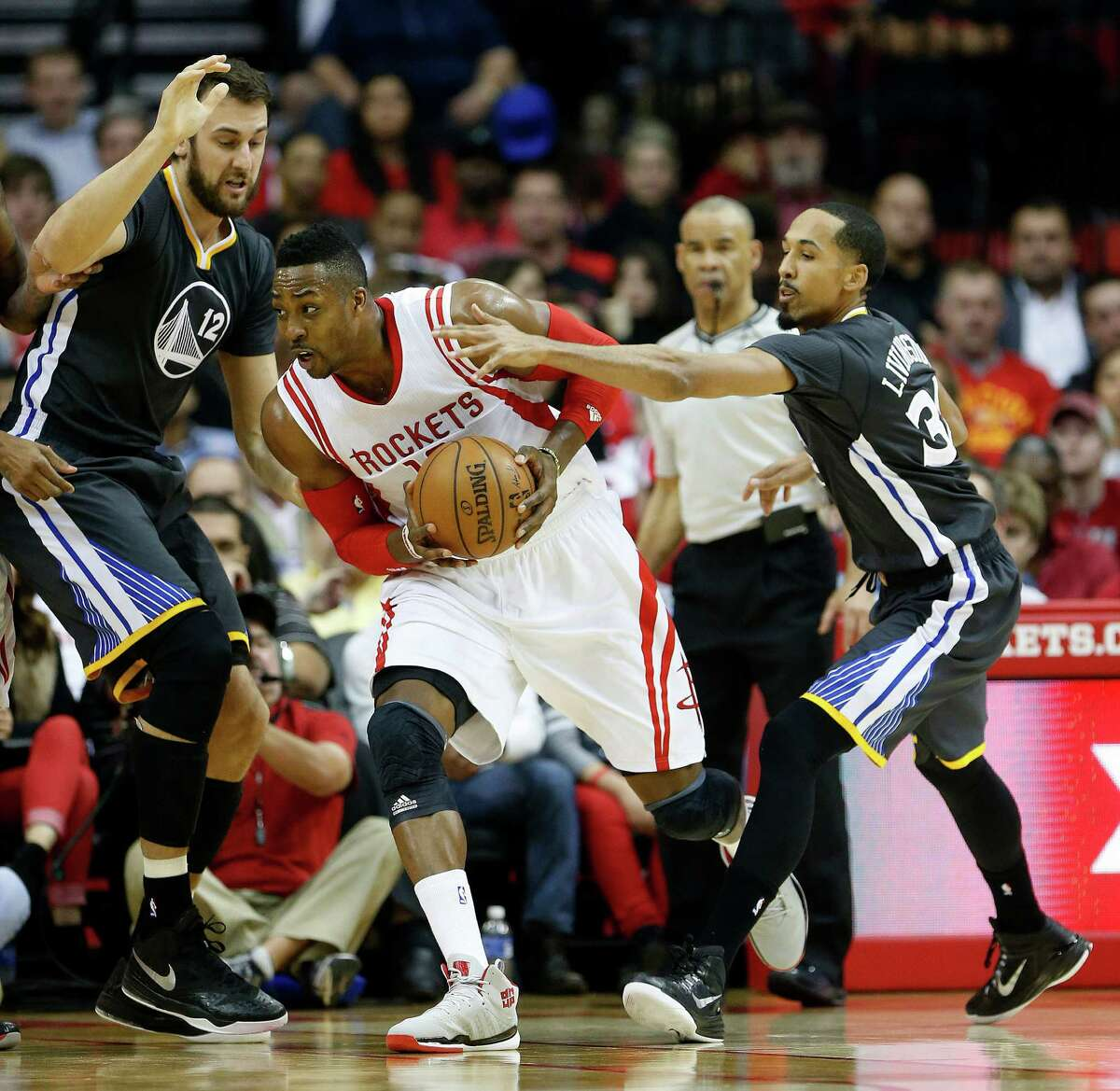 Dwight Howard, center, played against Andrew Bogut, left, and the Warriors twice this season, but those appearances were in two of the last four games Howard played before sitting out 26 games to deal with a knee problem.