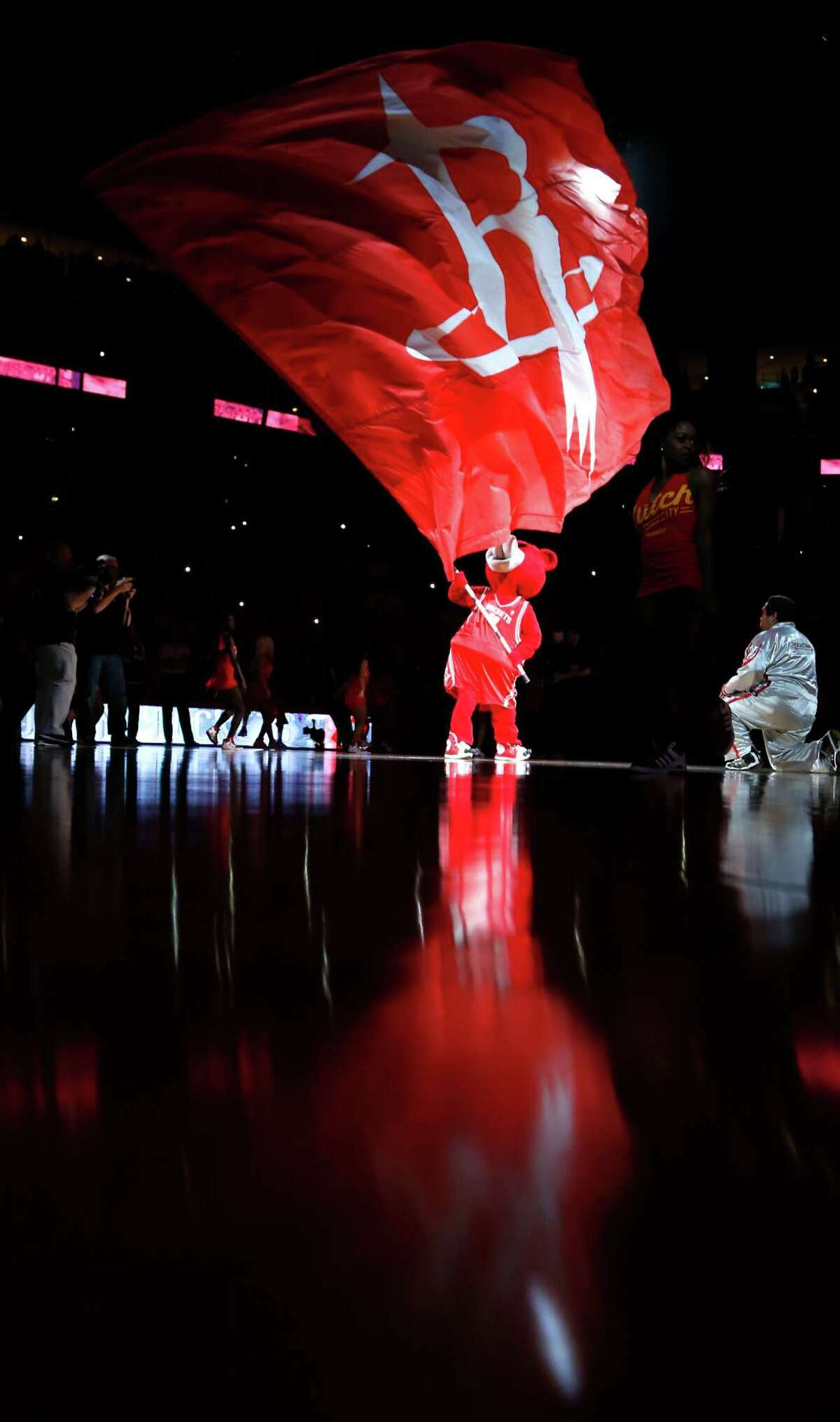 Houston Rockets mascot Clutch waves a Rockets flag before the start of Game 7 of the NBA Western Conference semifinals against the Los Angeles Clippers at the Toyota Center Sunday, May 17, 2015, in Houston. ( James Nielsen / Houston Chronicle )