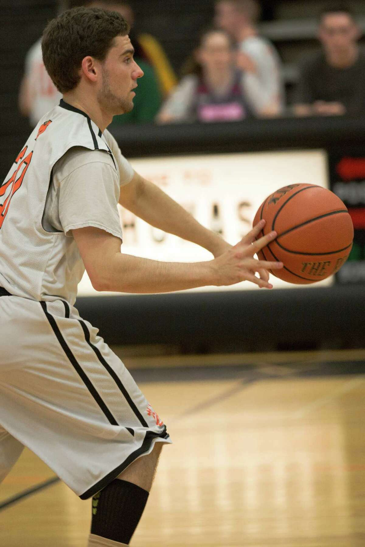 Cameron Kelly carries the ball across the court at the Mohonasen Unified Basketball game against Colonie High's Special Education Basketball league on May 18, 2015. (Karla Cote / Special to the Times Union)