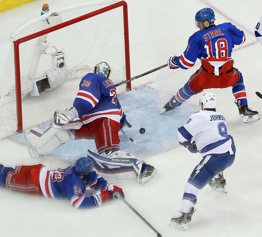 Rangers goalie Henrik Lundqvist turns to try to stop a shot by Tyler Johnson. Photo: Julie Jacobson / Associated Press / AP