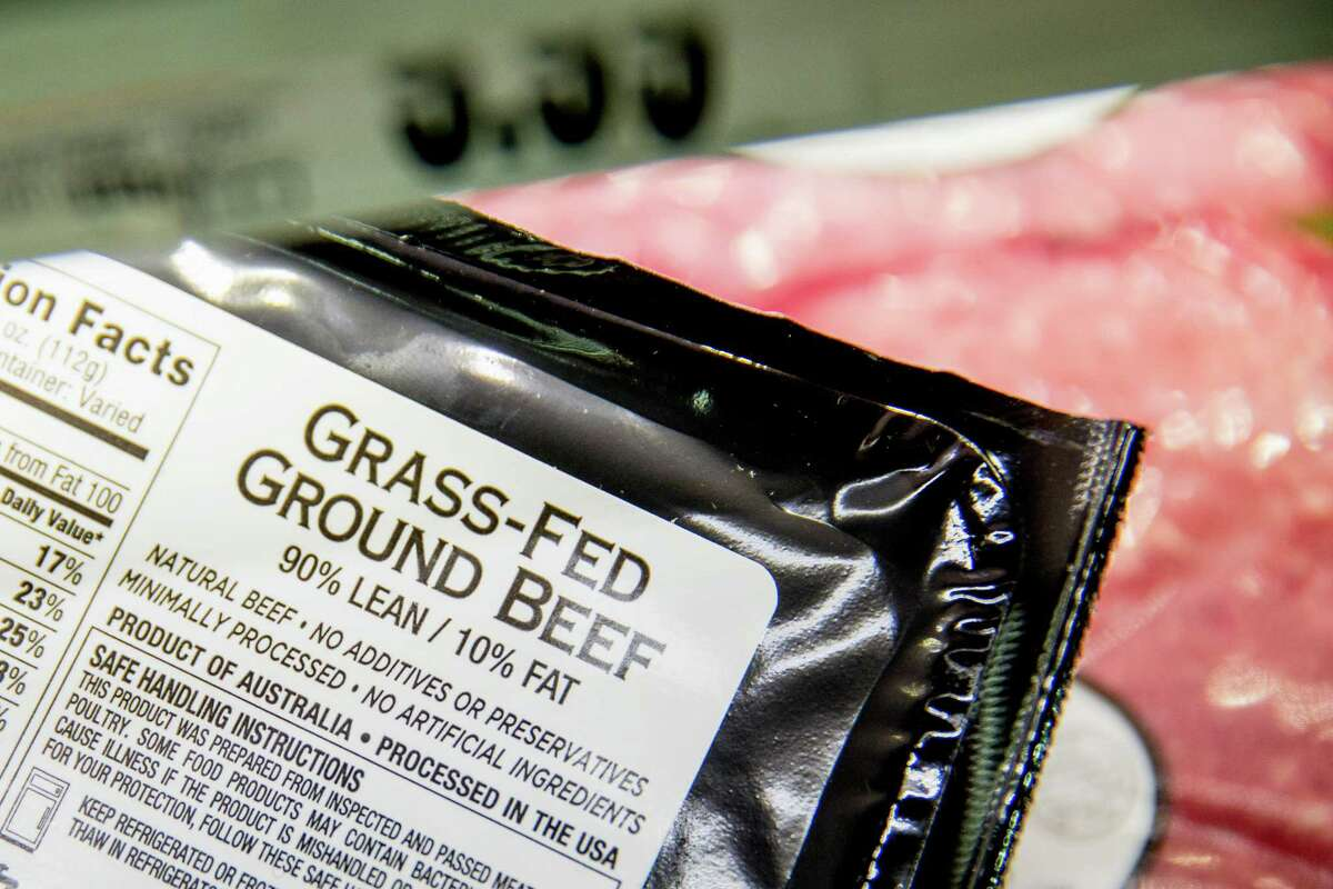 Meat labels are seen at a grocery store in Washington, Tuesday, May 19, 2015. Labels on packaged steaks and other cuts of meat in the United States that say where the animals were born, raised and slaughtered will have to be dropped or revised after a World Trade Organization ruling. The office of the U.S. Trade Representative said Monday that the WTO has rejected a final U.S. appeal, deciding that the U.S.