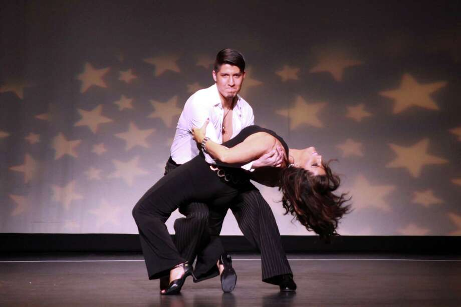 Local salon owner Maureen Clark Newlove and her professional dance partner, Moises Guerrero, took home the People's Choice Award for the female division at Curtain CallâÄôs 8th-Annual Dancing with the Stars event at the Palace Theatre May 16, 2015. Photo: Contributed Photo / Stamford Advocate  contributed