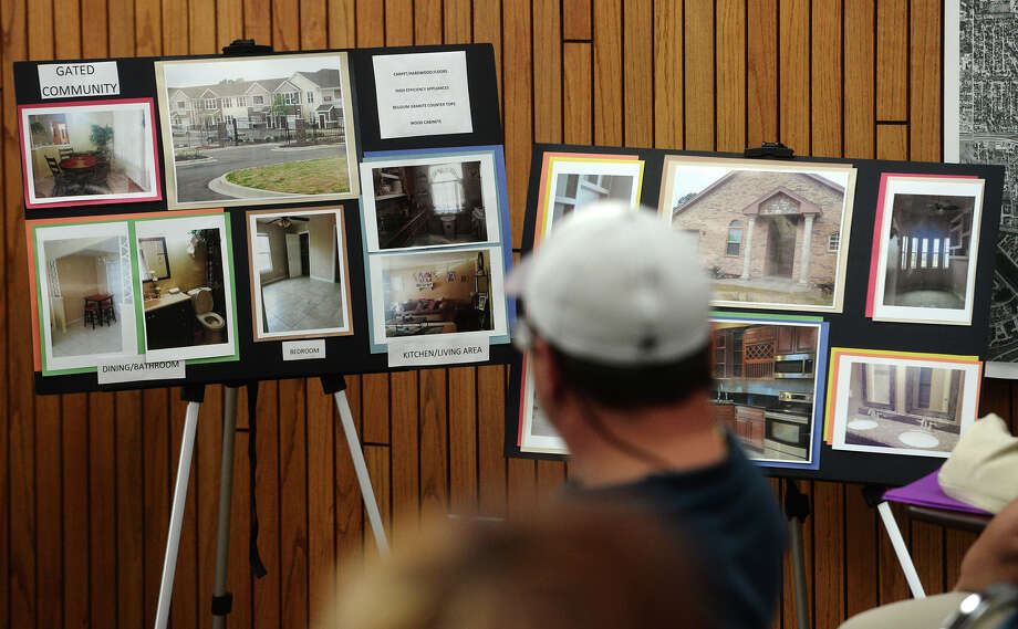 Boards with photos of other properties by the Axis Manor complex's owners are seen Monday. The Groves city council heard public comment about the proposed expansion of the Axis Manor apartment complex Monday evening.  Photo taken Monday 5/18/15  Jake Daniels/The Enterprise Photo: Jake Daniels / ©2015 The Beaumont Enterprise/Jake Daniels