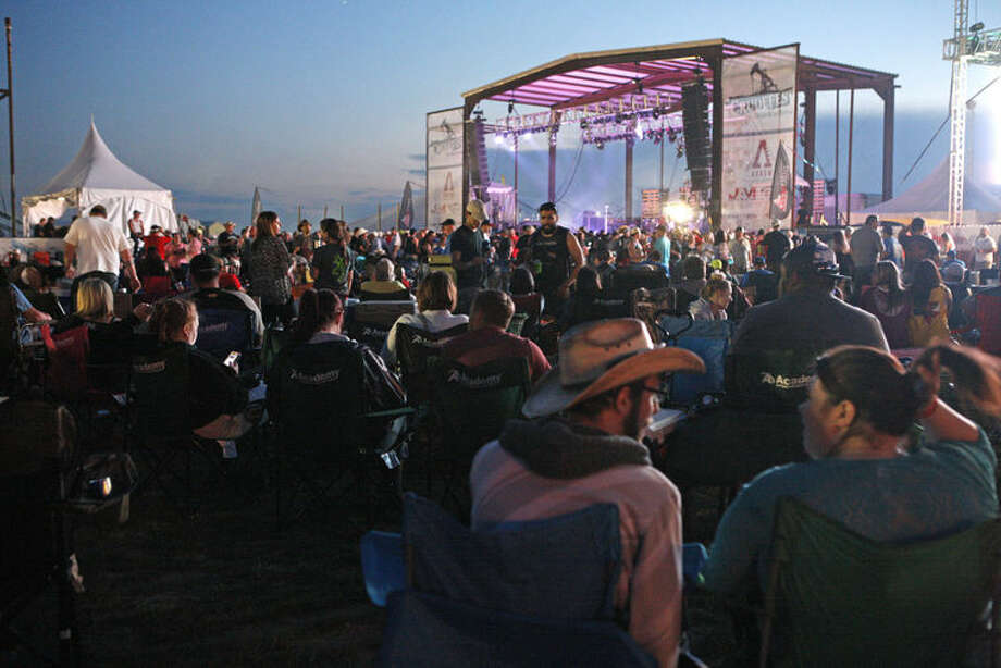 Hundreds of country music fans came to the 2015 Crude Fest in Midland, where headliners such as Josh Abbott Band filled the stage and nearby air with a country drawl of sound. Photo: Photo By James Durbin/MRT