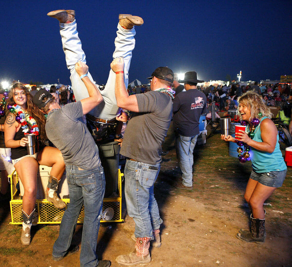 Hundreds of country music fans came to the 2015 Crude Fest in Midland, where headliners such as Josh Abbott Band filled the stage and nearby air with a country drawl of sound.