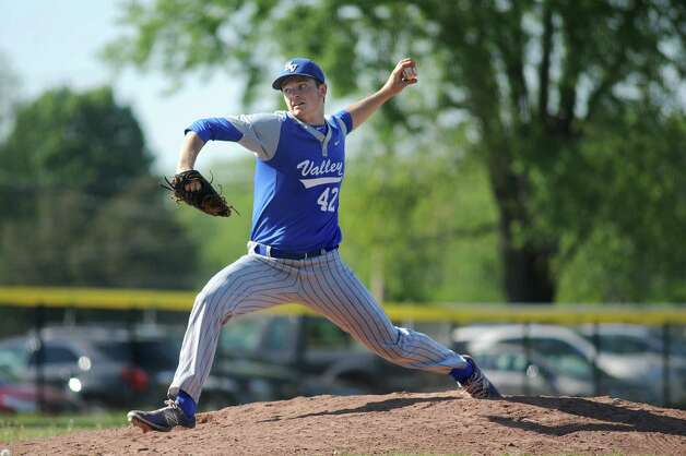 Hoosic Valley's John Rooney winds up the pitch during their baseball game against Greenwich on Thursday, May 14, 2015, at Hoosic Valley High in Schaghticoke, N.Y. (Cindy Schultz / Times Union) Photo: Cindy Schultz, Albany Times Union / 10031838A