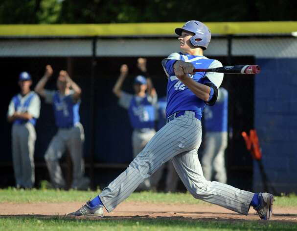 Hoosic Valley's John Rooney, right, connects with the ball during their baseball game against Greenwich on Thursday, May 14, 2015, at Hoosic Valley High in Schaghticoke, N.Y. (Cindy Schultz / Times Union) Photo: Cindy Schultz, Albany Times Union / 10031838A