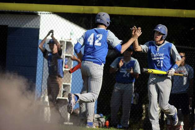 Hoosic Valley's John Rooney, left, celebrates his run with Don Joslin during their baseball game against Greenwich on Thursday, May 14, 2015, at Hoosic Valley High in Schaghticoke, N.Y. (Cindy Schultz / Times Union) Photo: Cindy Schultz, Albany Times Union / 10031838A