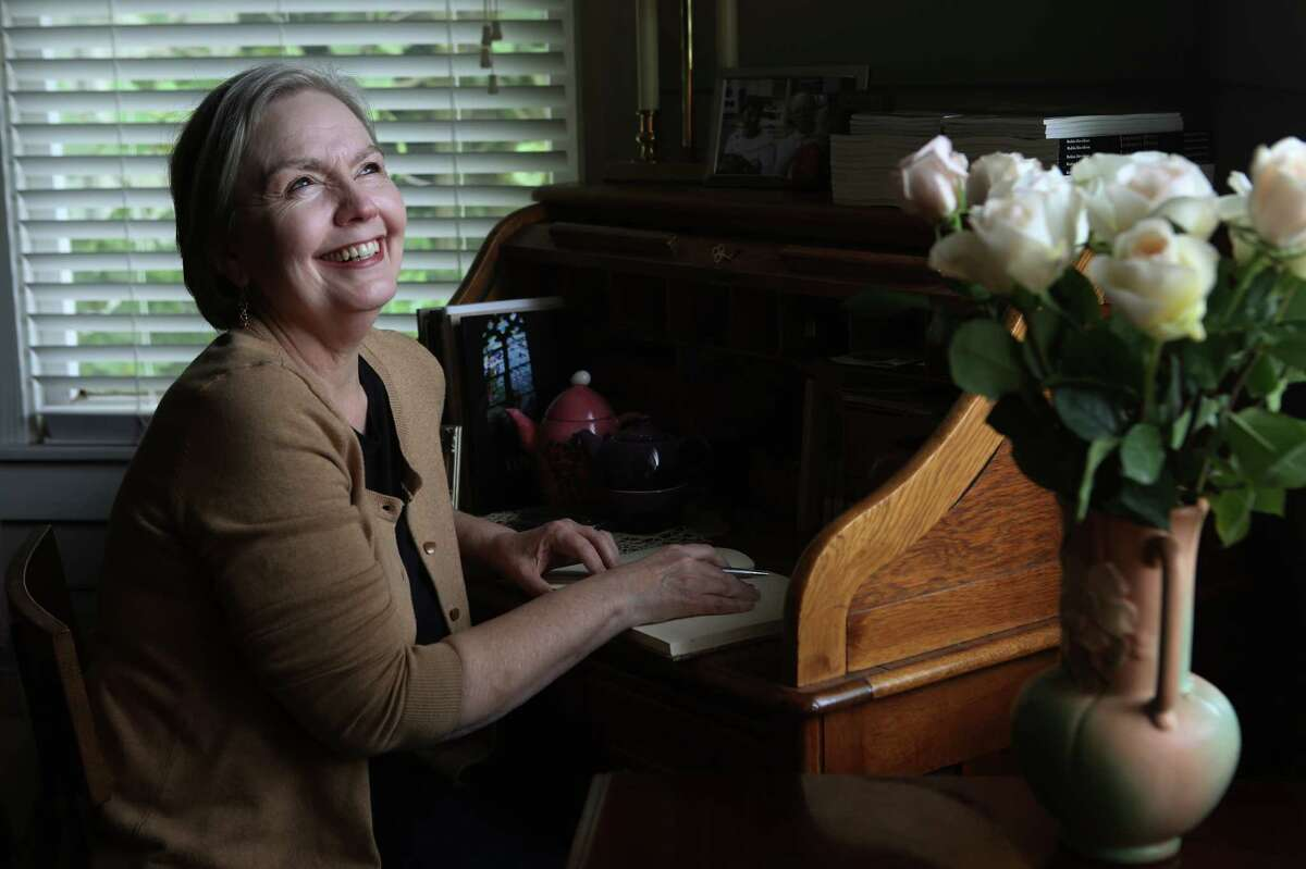 Robin Davidson, a poet and University of Houston-Downtown associate professor, in her home study. Davidson was named Houston's second poet laureate on May 19, 2015.