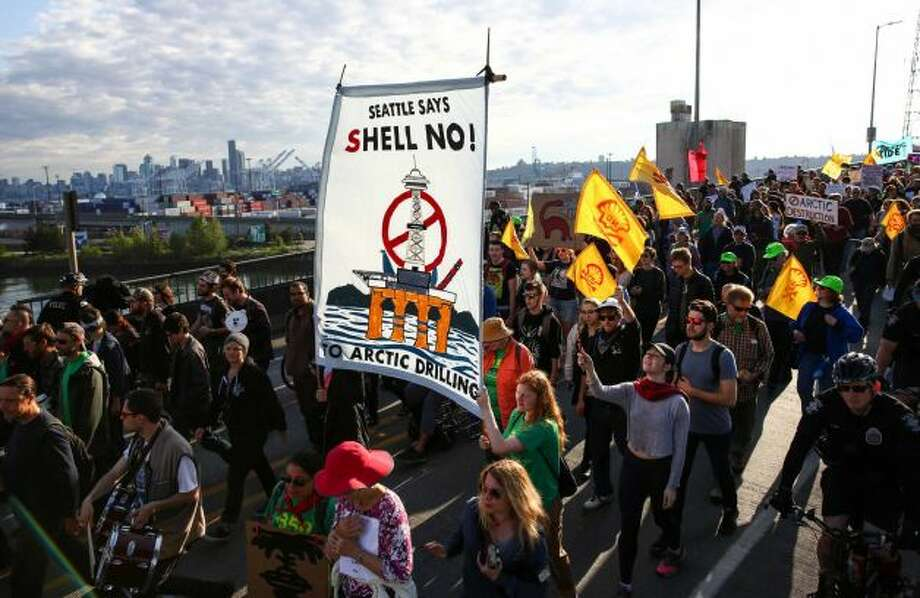 Marchers make their way over the Spokane Street bridge during a protest against Arctic oil drilling and the mooring of Shell Oil's Polar Pioneer drilling rig in Seattle. Protesters blocked entrances to the port during the protest. Photographed on Monday May 18, 2015. Photo: JOSHUA TRUJILLO, SEATTLEPI.COM