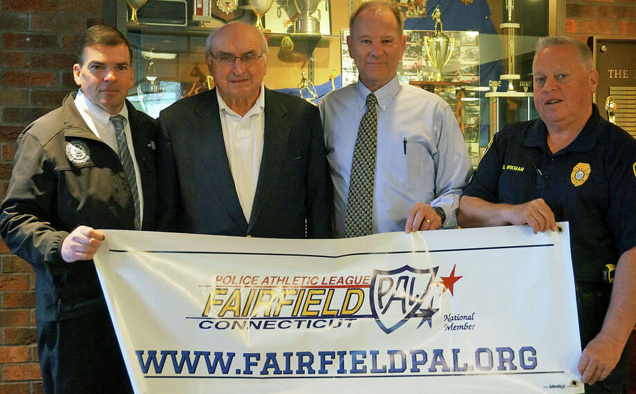 The Fairfield Police Athletic League will honor longtime member, U.S. Army veteran and retired police officer Frank Onder at Monday's Memorial Day Parade. From left are Chief Gary MacNamara, Onder, Bob Seirup, PAL secretary, and Officer Gary Wikman, current PAL president. Photo: Genevieve Reilly / Fairfield Citizen
