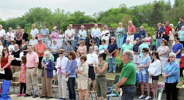 The faithful attend the Parish of Holy Trinity's outdoor Mass said by Bishop Edward B. Scharfenberger, during Cohoes Heritage Days Saturday May 16, 2015 in Cohoes, NY.   (John Carl D'Annibale / Times Union) Photo: John Carl D'Annibale / 00031813A