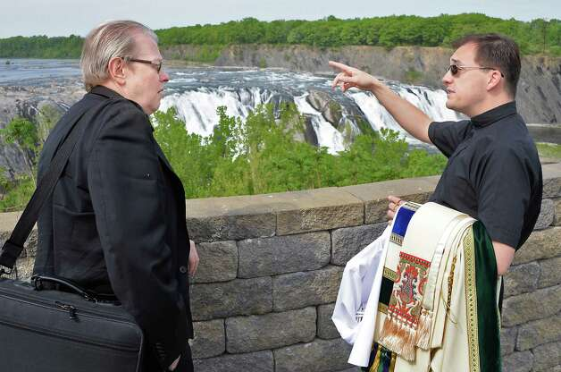 Bishop Edward B. Scharfenberger, left, gets a tour of the Cohoes Falls from Parish of Holy Trinity Pastor James Ebert before an outdoor Mass during Cohoes Heritage Days 2015 Saturday May 16, 2015 in Cohoes, NY.  (John Carl D'Annibale / Times Union) Photo: John Carl D'Annibale / 00031813A
