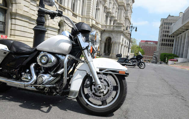 Motorcycle safety advocates parked outside the Capitol on State St. for rally where they met with lawmakers to raise awareness about biker safety Monday afternoon, May 18, 2015, in Albany, N.Y. Parking along State St. was reserved for the bikers. (Will Waldron/Times Union) Photo: WW, Albany Times Union
