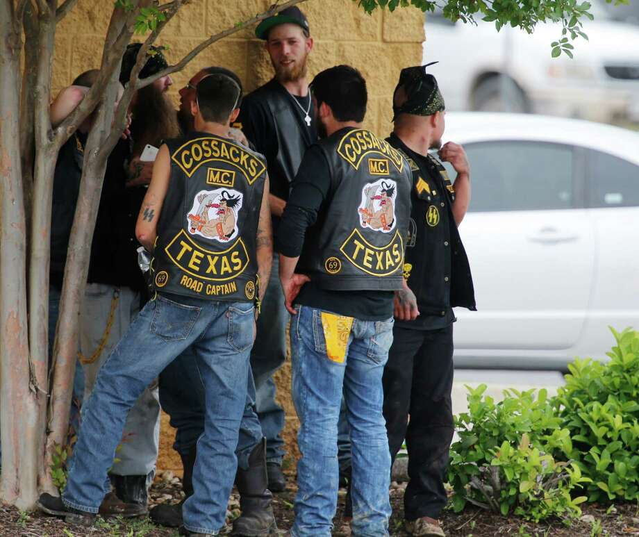 Bikers stand near a wall while authorities investigate the deadly shooting in Waco on May 17. Photo: Rod Aydelotte /Waco Tribune-Herald / Waco Tribune-Herald