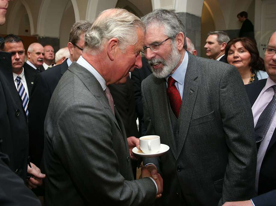 Britain's Prince Charles. left, shakes hands with Sinn Fein president Gerry Adams at the National University of Ireland in Galway, Ireland, Tuesday May 19, 2015. Prince Charles has begun an official visit to Ireland featuring two new milestones of peacemaking: his first meeting with leaders of the Irish nationalist Sinn Fein party, and his first trip to the fishing village where the Irish Republican Army killed his great-uncle 36 years ago. It is Charles' third trip to the Irish Republic since the outlawed IRA called a 1994 cease-fire. (Brian Lawless/Pool photo via AP) Photo: Brian Lawless, Associated Press