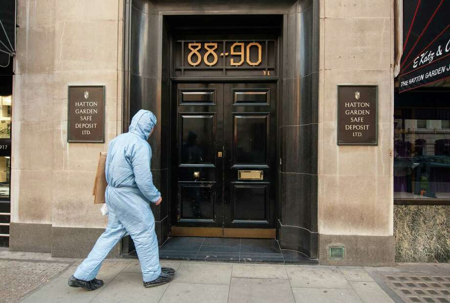 A police forensics officer enters the Hatton Garden company in London's diamond district after thieves appeared to have pulled off the perfect robbery. Photo: Dominic Lipinski / Associated Press / PA