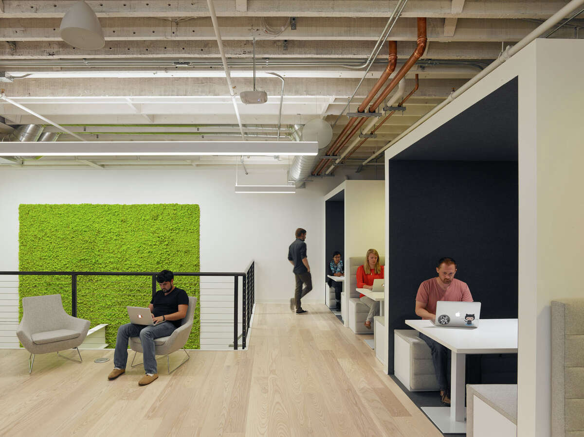Zendesk's office in San Francisco has a green moss wall between the company's reception area and basement floor.