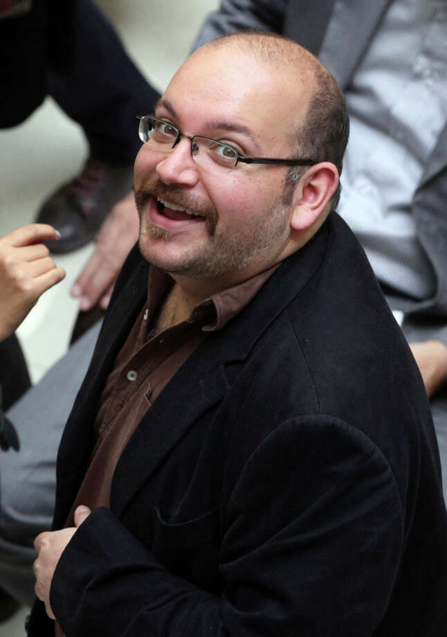 Reporter Jason Rezaian smiles at a 2013 campaign rally for President Hassan Rouhani in Tehran. Photo: Vahid Salemi / Associated Press / AP