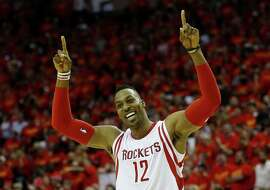 HOUSTON, TX - MAY 17:  Dwight Howard #12 of the Houston Rockets celebrates after they defeated the Los Angeles Clippers 113 to 100 during Game Seven of the Western Conference Semifinals at the Toyota Center for the 2015 NBA Playoffs on May 17, 2015 in Houston, Texas. NOTE TO USER: User expressly acknowledges and agrees that, by downloading and/or using this photograph, user is consenting to the terms and conditions of the Getty Images License Agreement.  (Photo by Scott Halleran/Getty Images) ***BESTPIX***