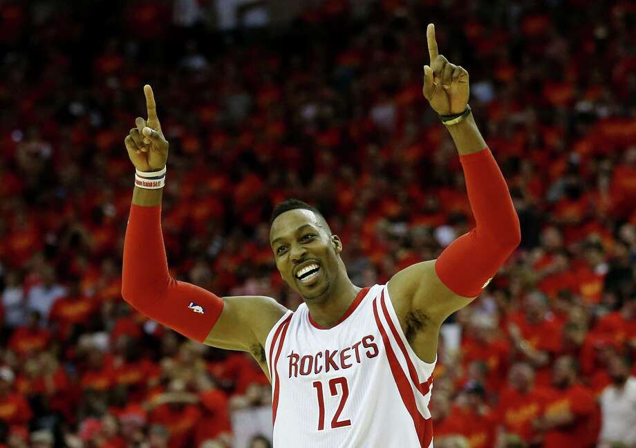 HOUSTON, TX - MAY 17:  Dwight Howard #12 of the Houston Rockets celebrates after they defeated the Los Angeles Clippers 113 to 100 during Game Seven of the Western Conference Semifinals at the Toyota Center for the 2015 NBA Playoffs on May 17, 2015 in Houston, Texas. NOTE TO USER: User expressly acknowledges and agrees that, by downloading and/or using this photograph, user is consenting to the terms and conditions of the Getty Images License Agreement.  (Photo by Scott Halleran/Getty Images) ***BESTPIX*** Photo: Scott Halleran / 2015 Getty Images