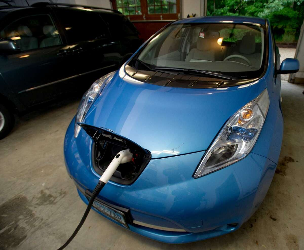 Etta Kantor's Nissan Leaf sits plugged into the wall of her New Canaan home on Thursday, June 13, 2013.