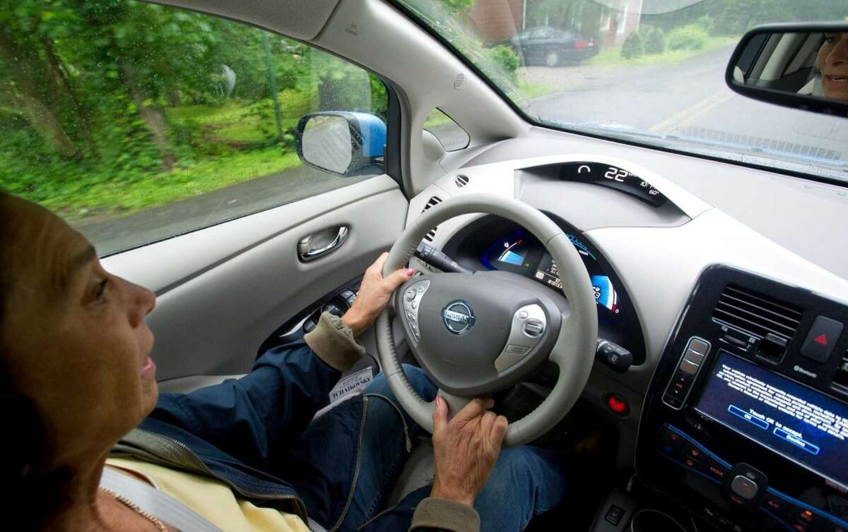 Etta Kantor drives her Nissan Leaf in New Canaan on Thursday, June 13, 2013.