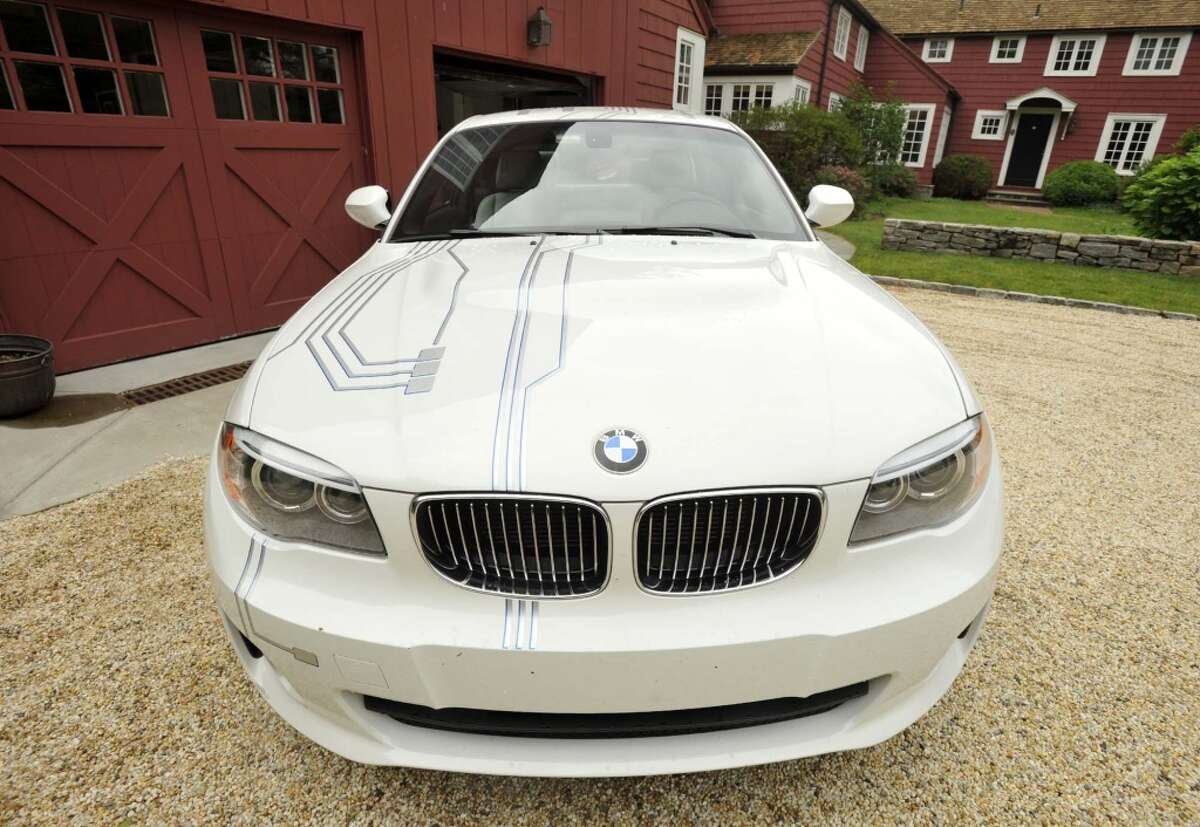 Bruce Redman Becker's BMW ActiveE fully-electric car sits in the driveway of his home in Westport on Thursday, June 13, 2013.