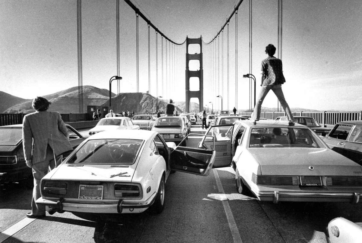 Gridlock on the Golden Gate Bridge, June 3, 1980: Commuters can only stand and watch as a traffic jam forms. Longtime Chronicle photographer and photo editor Gary Fong, who was stuck in the same gridlock, stepped outside his car, and took one of the most memorable photos in Chronicle history.