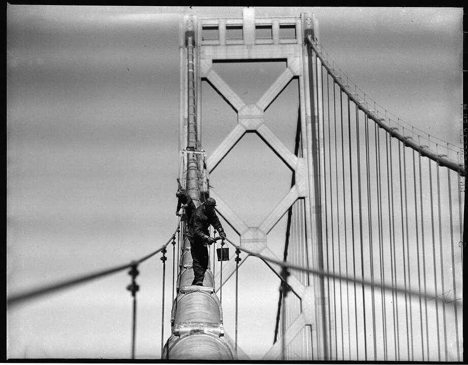 1948: Workers paint the western span of the Bay Bridge when it was more than a decade old. The Bay Bridge was erected less than a year before the Golden Gate Bridge and declared by Franklin Delano Roosevelt to be the greatest construction project in U.S. history. Photo taken by Duke Downey, a longtime Chronicle photographer who often put himself in precarious places to get a great result. Photo: Duke Downey, The Chronicle