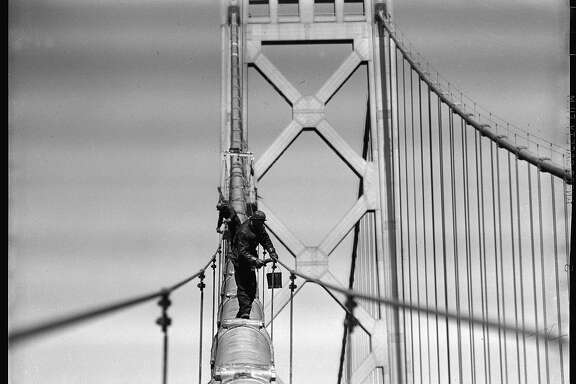 1948: Workers paint the western span of the Bay Bridge when it was more than a decade old. The Bay Bridge was erected less than a year before the Golden Gate Bridge and declared by Franklin Delano Roosevelt to be the greatest construction project in U.S. history. Photo taken by Duke Downey, a longtime Chronicle photographer who often put himself in precarious places to get a great result.
