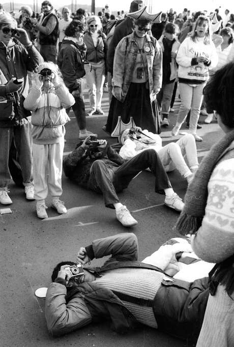 May 24, 1987: Tourists bend every which way in an attempt to get a photo souvenir of the 50th anniversary of the Golden Gate Bridge. More than a million visited the bridge on the anniversary. The photo was taken by Steve Ringman, a longtime Chronicle photographer known for his innovative concert images in the 1980s. Photo: Steve Ringman, The Chronicle